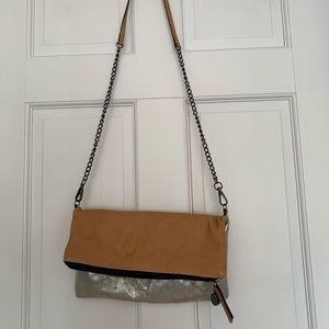 Loft handbag with long removable shoulder strap.
